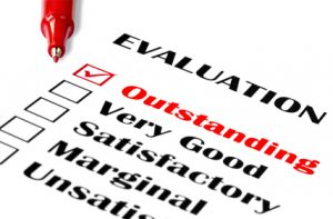 """Outstanding evaluation. Red pen on evaluation, with """"outstanding"""" checked."""